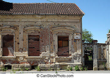 Destroyed house as war aftermath. The Croatian War of...