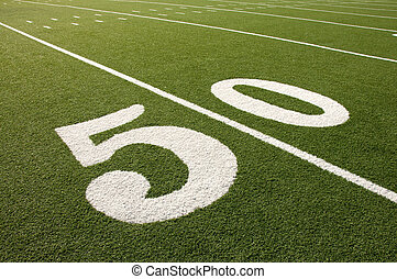 American Football Field 50 Yard Line - Closeup of 50 yard...