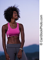 portrait of african american woman jogging in nature