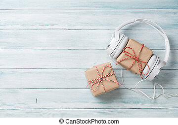 Christmas music gift concept. Headphones and gift boxes on...