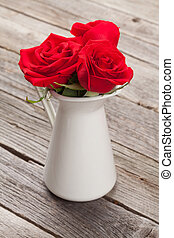 Red rose flowers in pitcher
