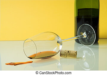 Spilled wine - Fallen wineglass and red wine spilled on the...