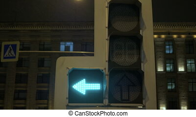 Traffic lights regulate the movement of vehicles. At night...