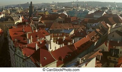Tiled roofs of old town of Prague on a sunny day, Czech Republic. 4K overview pan shot