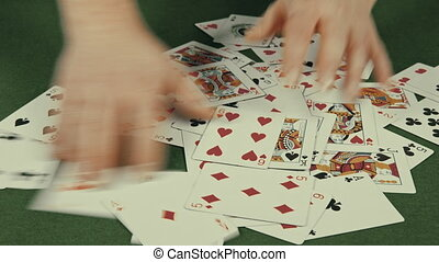 casino, the dealer interferes with playing cards.