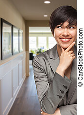 Curious Mixed Race Woman Inside Hallway of House