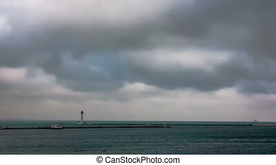 Lighthouse with dramatic clouds. - Lighthouse and Ships with...