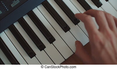 playing hand man piano synthesizer hand run over keys -...