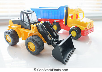 Toy Wheel Loader and Toy Dump Truck Close up, Toy Industrial...