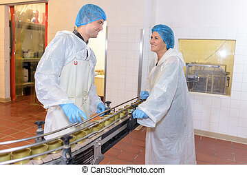 canning workers having a conversation