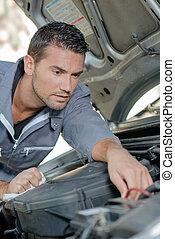 Man fixing a car engine