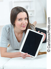 Woman using her tablet computer