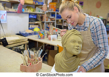 Female artist sculpting