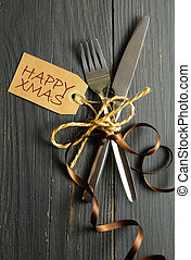 Christmas meal background - Fork and knife tied together on...