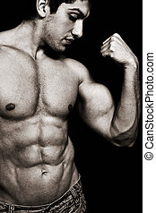 Sexy man with muscular biceps and abs - Portrait of sexy...