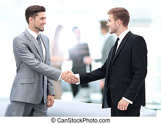 Business people shaking hands during a meeting - Business...
