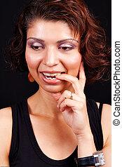 Idea concept - pensive happy indian woman