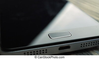 Fingerprint security screen unlocking on a smartphone. -...
