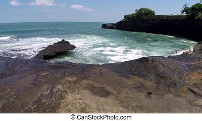 Remote ocean bay with stony coastline and waves - View of...