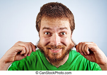 Funny silly man grabbing his hairy beard - One funny silly...