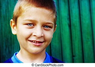 Portrait of cute boy with natural smile