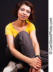 Studio portrait of one casual middle aged woman - Studio...