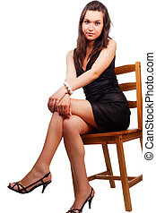 Woman with nice sexy legs sitting on chair