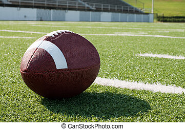 Closeup of American Football on Field - Closeup of American...