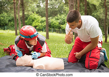 Cpr practice on cpr dummy - Cpr practice of woman and man on...