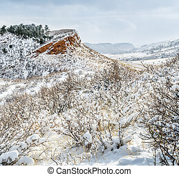 Colorado foothills in fresh snow - sandstone cliffs and...