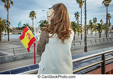 modern woman in earmuffs in Barcelona with Spanish flag - in...