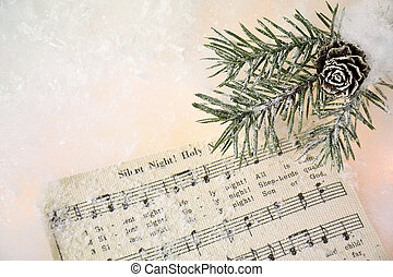 Christmas music in snow - holiday music with frosted pine in...