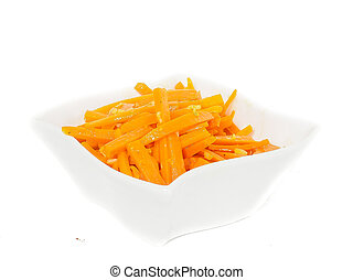Closeup of carrot cut into julienne slices in a beautiful white bowl against white