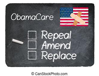 Obamacare concept using chalk on slate blackboard -...