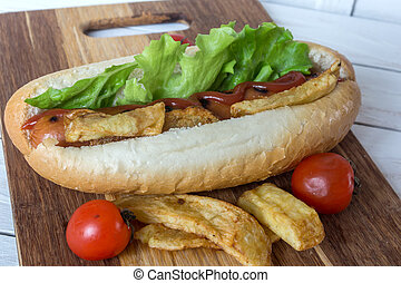 Barbecue Grilled Hot Dog with ketchup, french fries and Cherry tomatoes