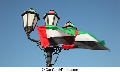 Flags of the United Arab Emirates at a lantern in the...