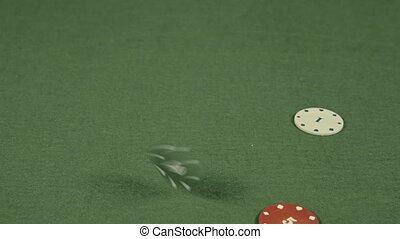 casino chips falling on a table.