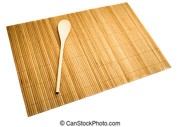 Wooden spoon on mat of bamboo