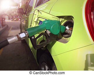 Fill the machine with fuel or car refueling at petrol...