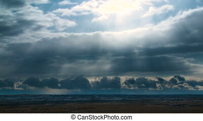 Cloud Scape Time-lapse - Beautiful clouds pass over a cold...