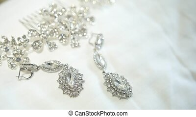 Wedding accessories on the white surface, glare and...