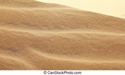 Sand dune with wind - Moving sand on the dune on a sunny...