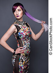 Beautiful girl in colorful dress with avant-garde...