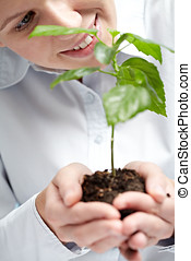 Genetic laboratory test - A young female botanist holding...