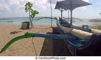 View of boat on the beach. Bali, Indonesia - View of wooden...
