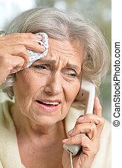 Senior woman talking on the phone