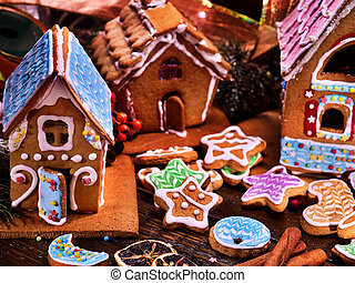 Many colored gingerbread houses for Christmas. Glazed...