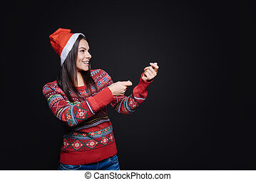 Amused girl holding an invisible petard - Holiday...