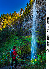 Watson Falls Backpacker in Oregon - Girl Hiker admiring...