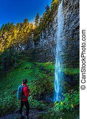 Watson Falls Backpacker in Oregon - Girl Hiker admiring...